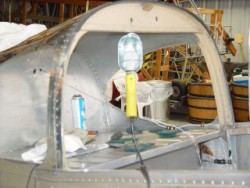 Stripping paint from the rear of the cockpit of a Globe Swift.