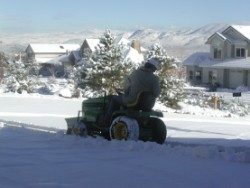 Clearing snow from the driveway.