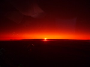 Sunrise over the North Atlantic taken through the aircraft sun shade..