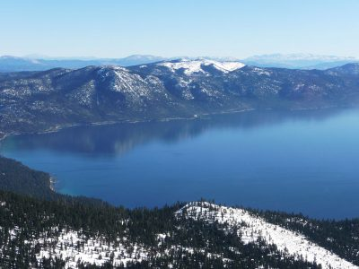 Photo of Lake Tahoe looking east from about Kings Beach with Incline VIllage out of the picture to the left.