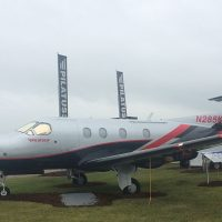 Pilatus PC-12 in front of their display area.